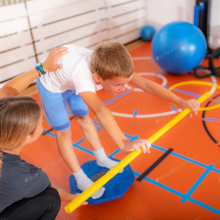 Balance exercises for children, using balancing disks
