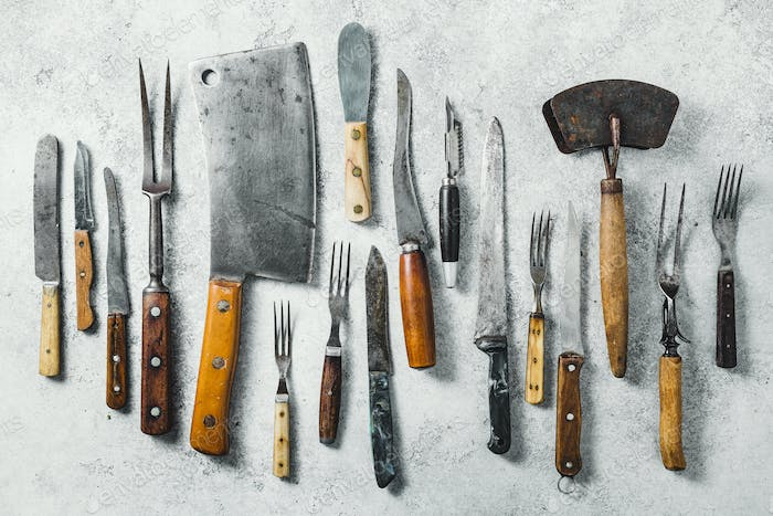 Old knifes on a grey background