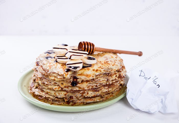 Stack of Thin pancakes with Honey,Banana