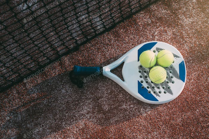 Padel blade racket on the floor