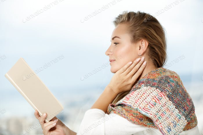 Calm female reading book