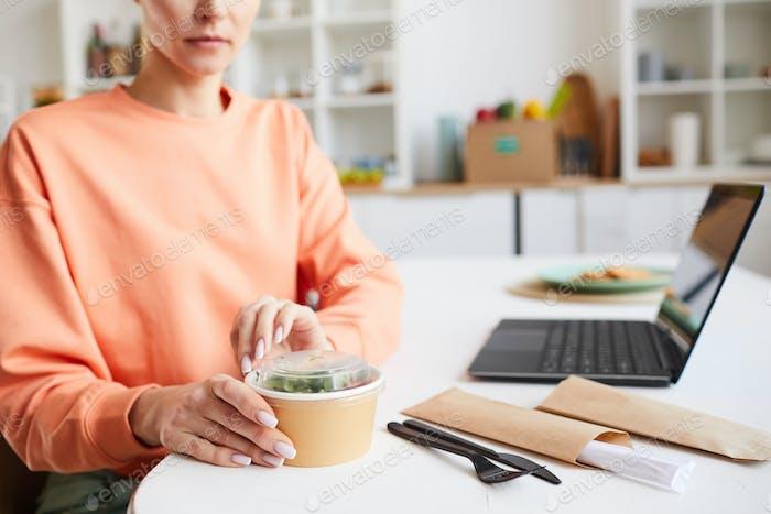 Woman eating takeaway food