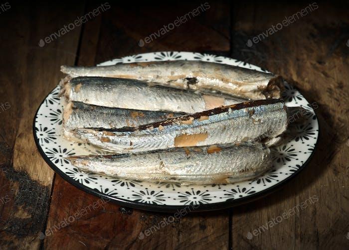 plate of marinated sardines, on rustic wood