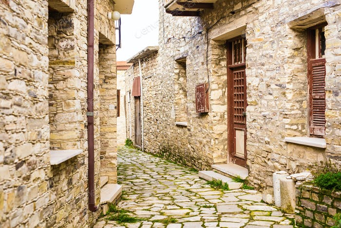 Beautiful view of scenic narrow alley with historic traditional houses in an old town in Europe