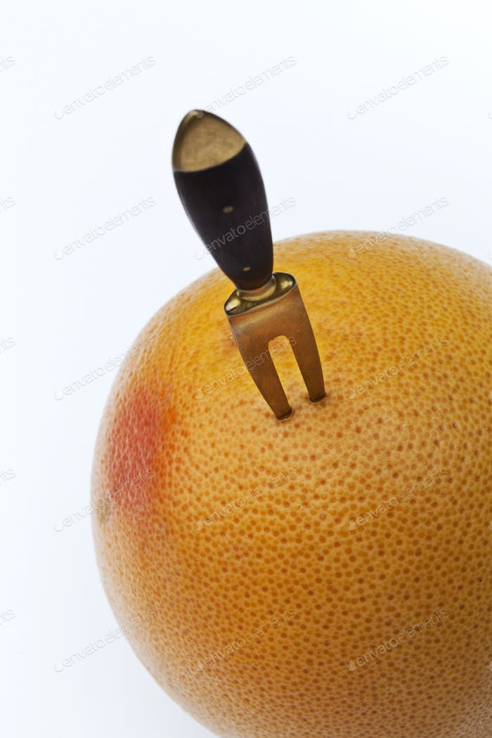 Fork in a grapefruit