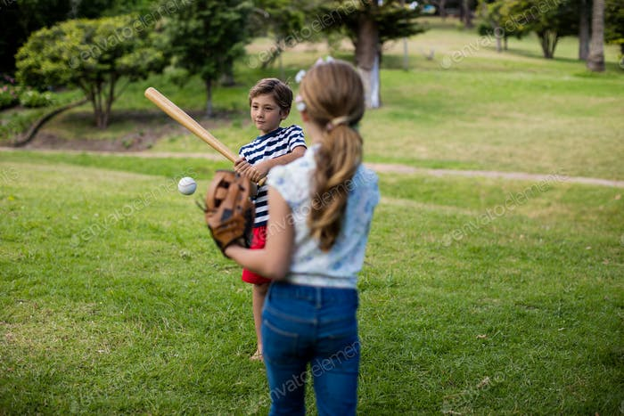 Boy and girl playing baseball
