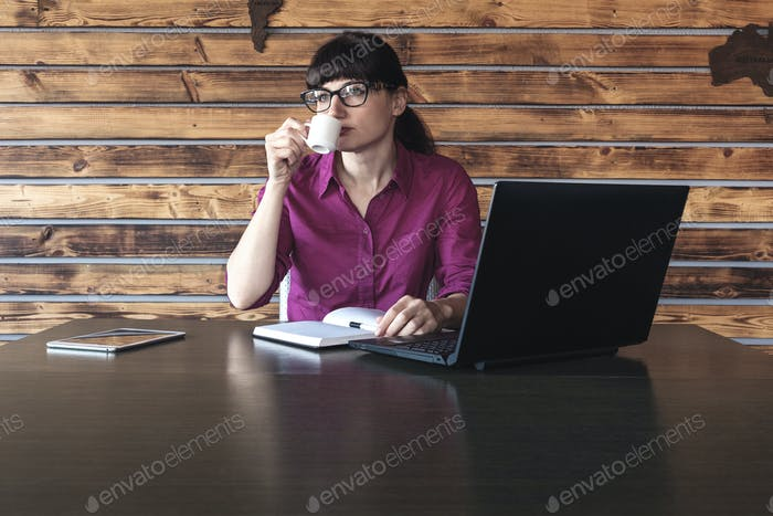 Businesswoman concentrating on her work