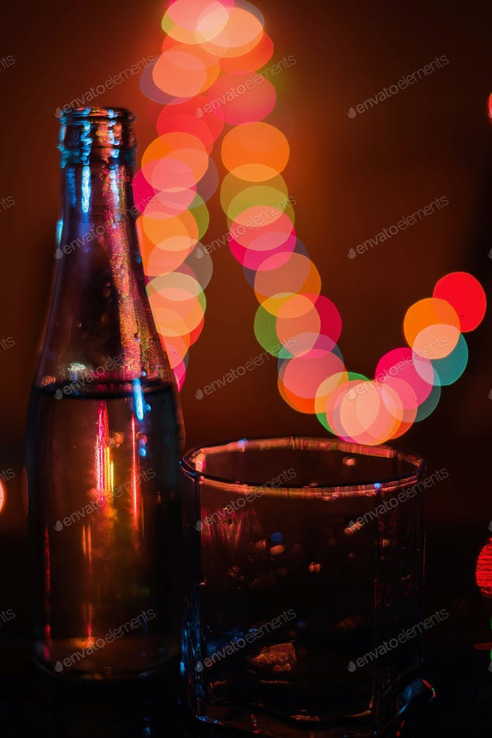 Buttle and glass with night light