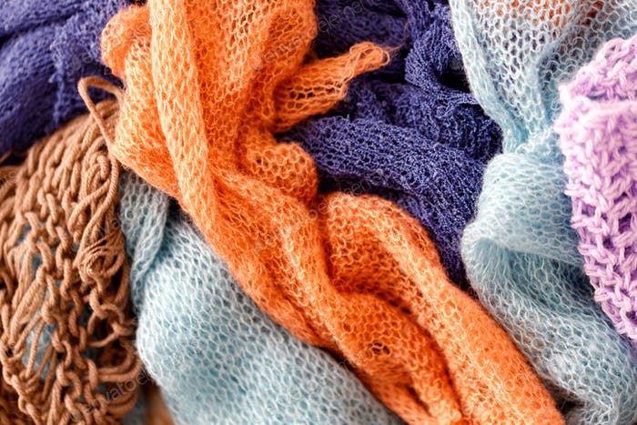Knitting Wool Texture. Background texture of pattern knitted fabric made of cotton or wool closeup