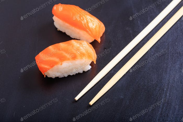 Nigiri salmon on black background