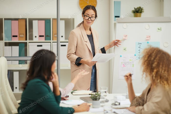 Elegant Asian Woman Making Presentation