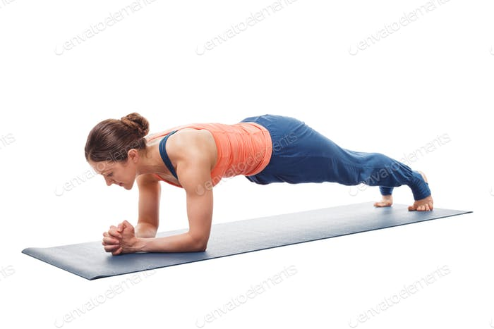 Woman doing Yoga asana Chaturanga dandasana  plank pose