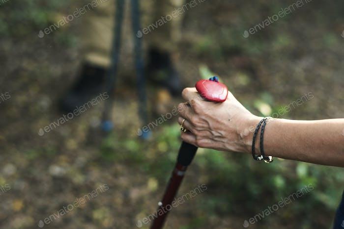 Woman using a trekking pole