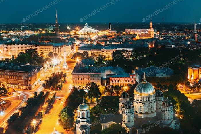 Riga, Latvia. Evening Night Aerial View Cityscape, Landmarks St. Peter's Church, Boulevard Of