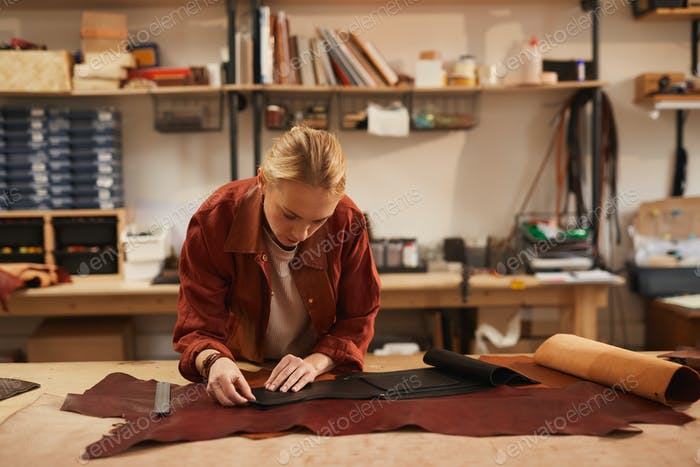 Craftswoman Working With Leather