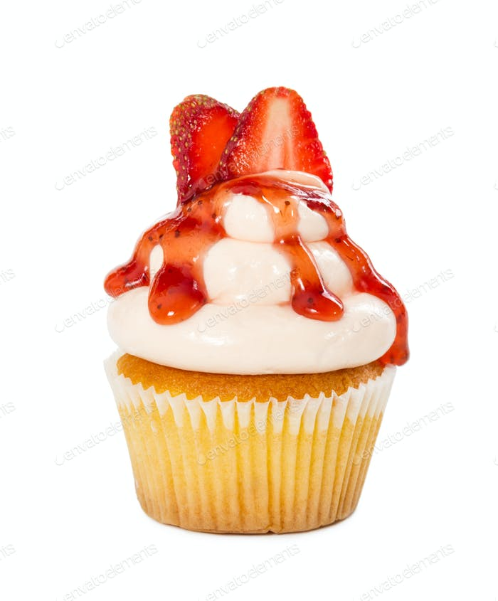 Cupcake with strawberry syrup and fresh strawberries isolated on