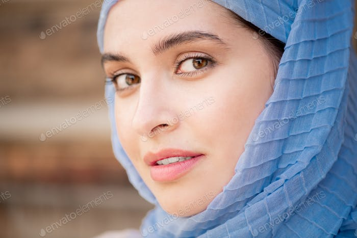 Young gorgeous muslim woman in blue hijab