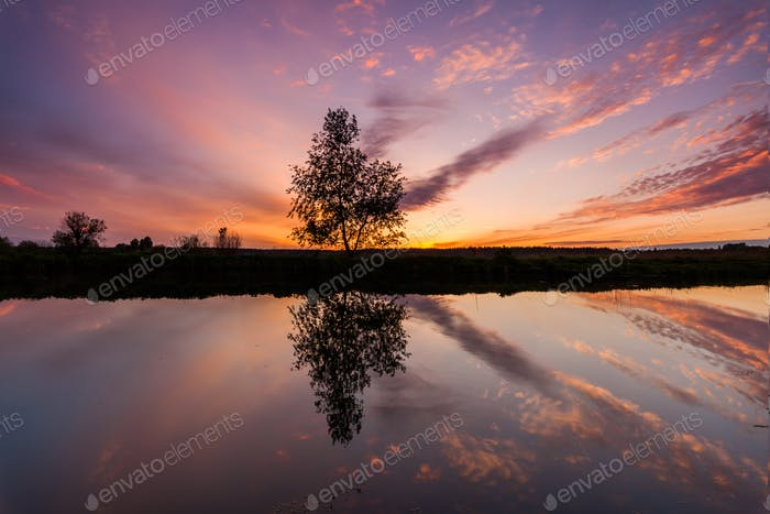 Reflection of a beautiful dawn sky in a river