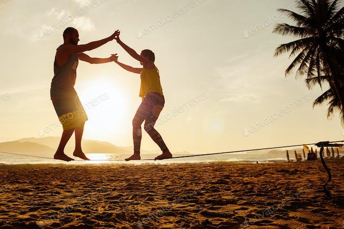 balancing on tight rope on beach