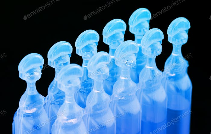 blue plastic medical ampoules packaging on black