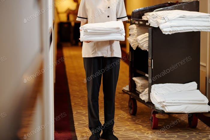 Hotel maid with fresh towels