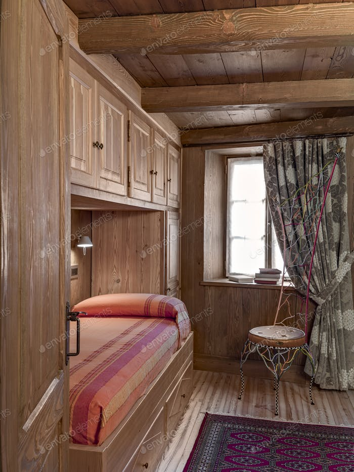 Interior of a Rustic Bedroom with Beamed Ceiling