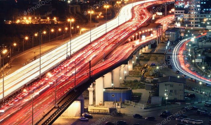 Traffic jam on automobile overpass at night