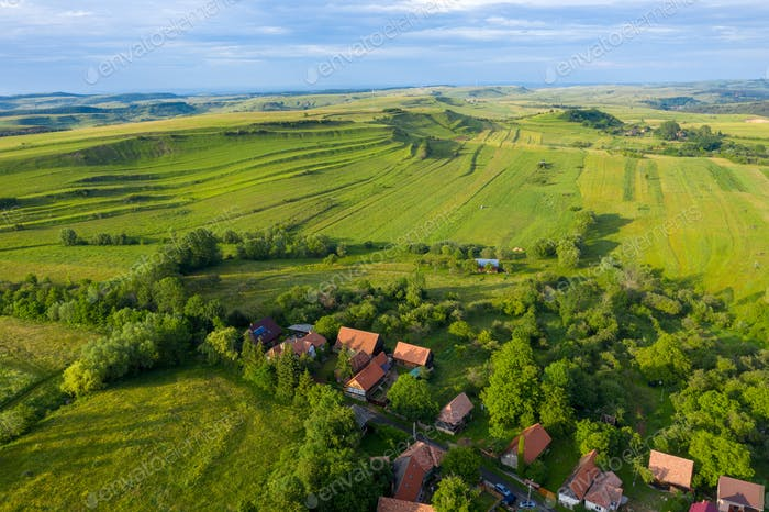Flying over a village in Transylvania. Aerial drone view of Manastireni, Romania by drone