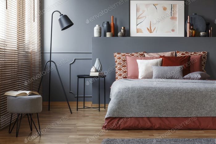 Grey bedroom interior with poster