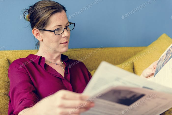 Caucasian woman reading the newspaper