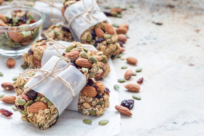 Homemade granola energy bars with figs, oatmeal, almond, dry cranberry and pumpkin seeds, copy space