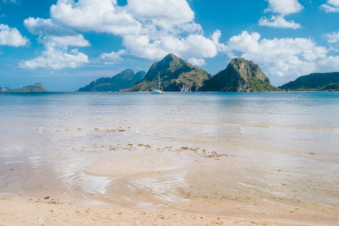 El Nido, Palawan,Philippines. Yacht boat in lagoon of Las Cabanas Beach with amazing mountains in