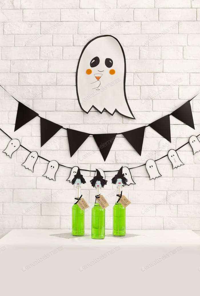 Tasting and sale of Halloween drinks over white bricks wall
