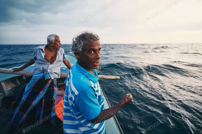 Two fishermen on fishing boat