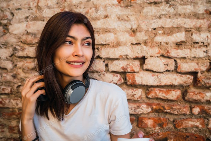 Young woman with headphones.