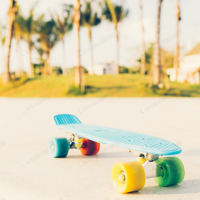 light blue longboard penny board with multicolored wheels ready