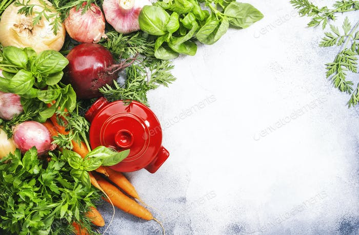 Assortment of fresh root vegetables and spicy herbs. Healthy food