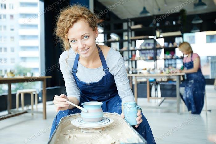 Female potter at work