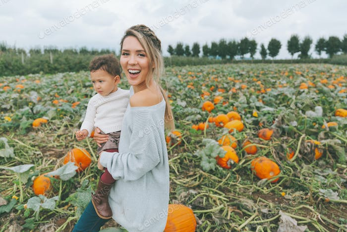 Mother and Daughter in a Pumpkin Patch