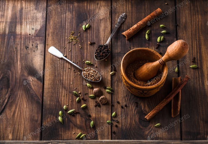 Making garam masala powder in mortar bowl