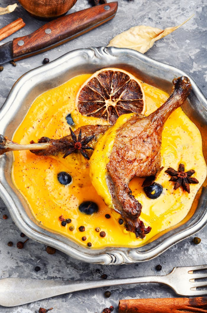 Baked duck leg in pumpkin puree