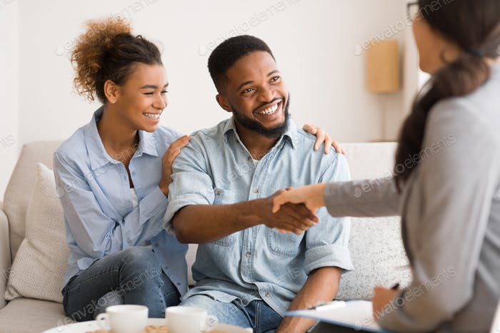 Young African American Couple Handshaking With Marriage Counselor After Therapy