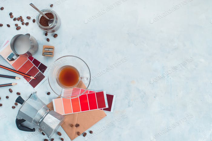 Color design production. Artist workplace from above. Moka coffee pot, color swatches, pencils