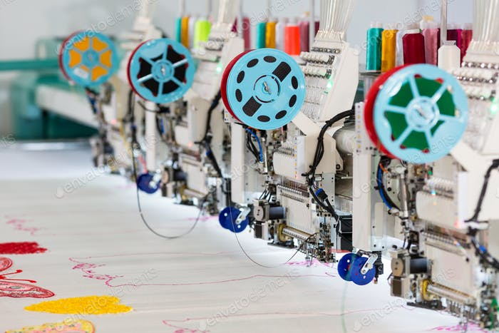 Factory sewing machine makes color pattern closeup