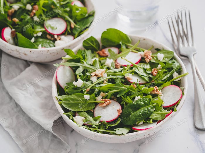 Salad bowl with arugula, spinach, radish, cheese