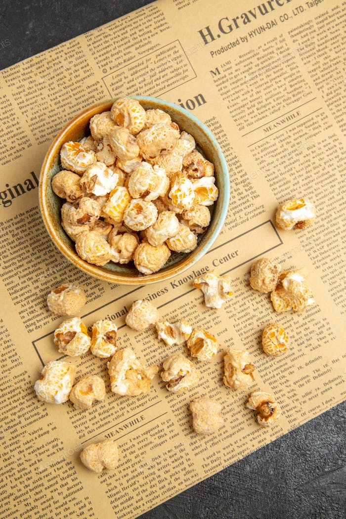 top view fresh sweet popcorn inside plate for movie time on dark background snack movie cinema food