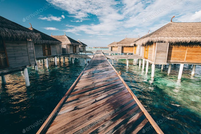Jetty leading to water villas. Maldives