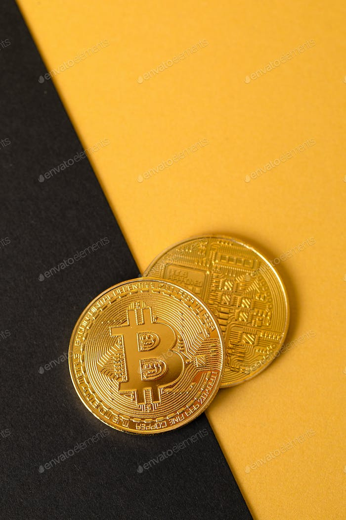 Bitcoins Crypto Currency Coin On Gold And Black Background