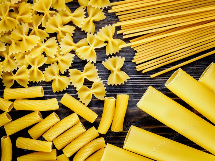Mix of different kind of paste - spaghetti, tortiglioni, cannelloni, farfalle, butterflies.
