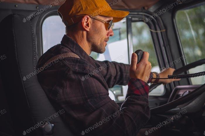Truck Driver Talking On Radio.